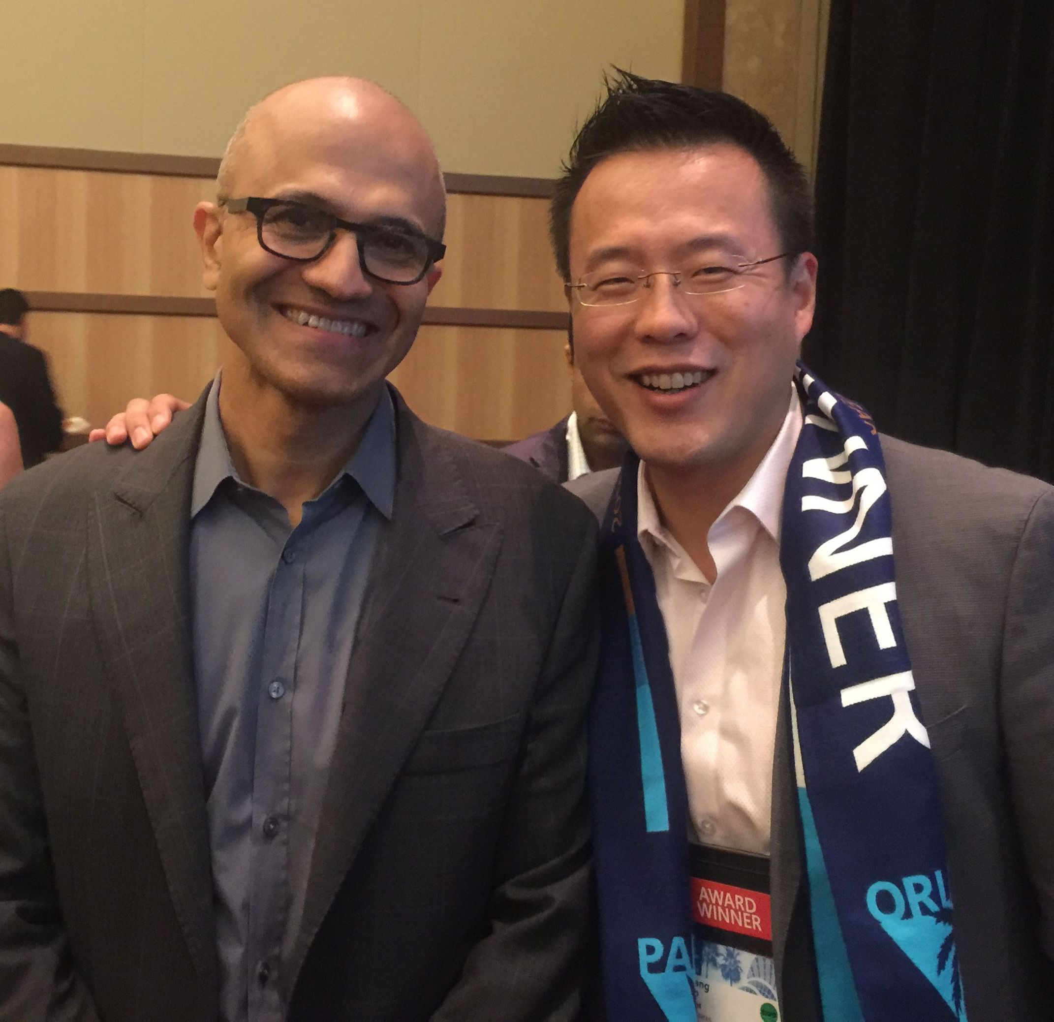 Microsoft CEO Satya Nadella and AvePoint Co-CEO and Co-Founder Dr. Tianyi (TJ) Jiang)